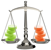 Balanced scales with green pills on left and orange pills on right