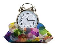 Alarm clock on pillow